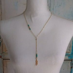 Boho style gold toned feather and bead necklace